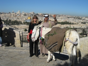An old Palestinian man with his donkey on the Mount of Olives like in a Biblical time