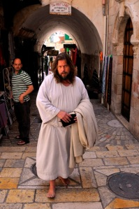 A visitor walking barefoot winter and summer in the old city of Jerusalem